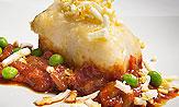 Merluza con salsa roja de pimientos