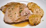 Cabeza de lomo de cerdo asada al horno con patatas